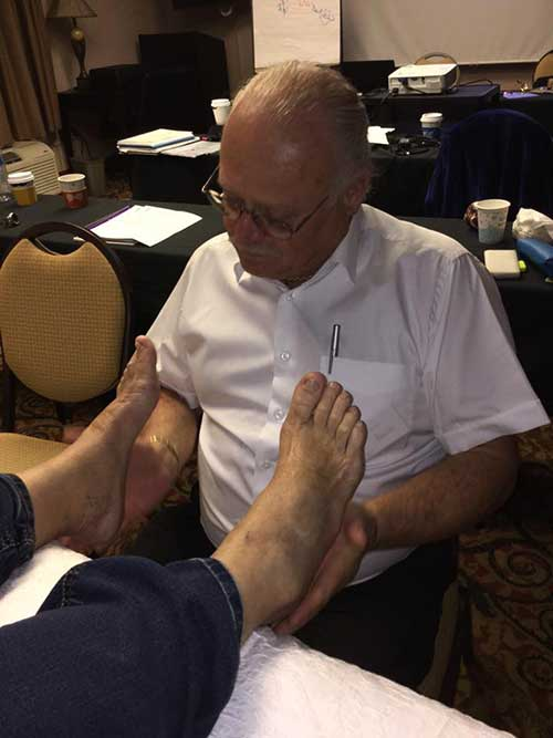 Moss demonstrating Chi Reflexology